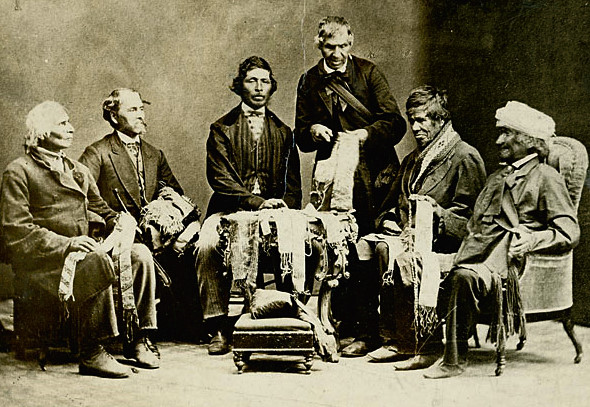 Black and white photograph of chiefs of the six nations, explaining their wampum belts to Horatio Hale in 1871, relevant to Seshat codebook